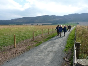 TRACKS Director Neil Kilpatrick leads staff from partner organisations along part of the newly completed trail.