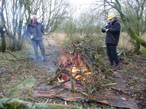 Richard and Craig getting the fire started.  Corrugated iron sheets were used to protect the ground.